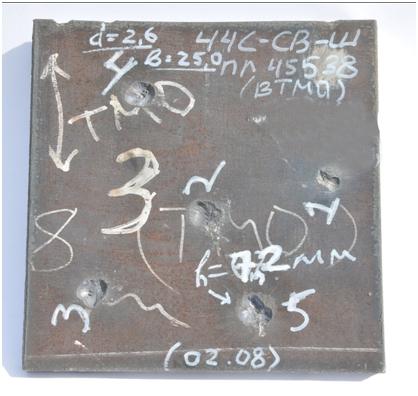 Образец стали 44С-св-Ш толщиной 25 мм после успешных испытаний бронебойной пулей Б32 калибра 12,7 мм  Фото: ОАО «НИИ стали».