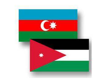 Флаги Азербайджана и Иордании.