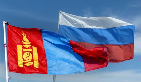 Флаги Монголии и России.