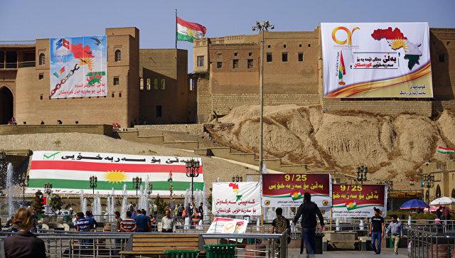 Агитационные плакаты, призывающие прийти на участки и проголосовать на референдуме о независимости Иракского Курдистана.