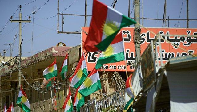 Агитационные плакаты, призывающие прийти на участки и проголосовать на референдуме о независимости Иракского Курдистана от Багдада, в Эрбиле. Архивное фото.