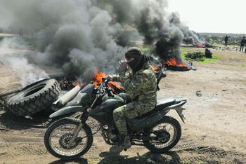 Борьба с партизанами всегда трудна и малоэффективна даже при массированном использовании сил. Фото Reuters