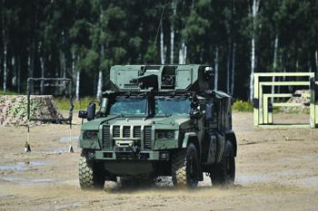 Бронеавтомобили становятся неотъемлемой частью всех родов войск. <br> Фото РИА Новости