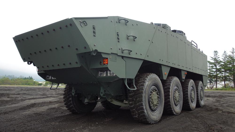 Прототип-демонстратор перспективного японского бронетранспортера с колесной формулой 8х8 по программе Wheeled Armoured Vehicle (Improved), разработанного организациями министерства обороны Японии в партнерстве с корпорацией Komatsu. Январь 2017 года