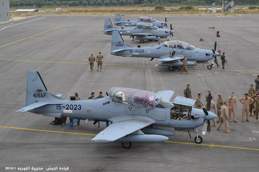 Четыре последних полученных ВВС Ливана из шести поставляемых США учебно-боевых самолета (легких штурмовика) Embraer EMB-314 (A-29В) Super Tucano. Самолеты сохранили бортовые номера ВВС США с 15-2023 по 15-2026 (серийные номера с.31400224 по 31400227 соответственно). Хамат (Бейрут), 28.05.2018.