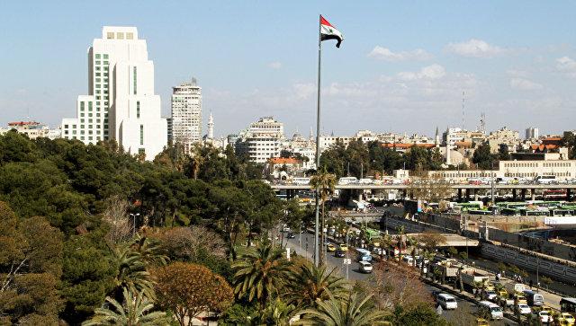 Флаг Сирии в Дамаске. Архивное фото.