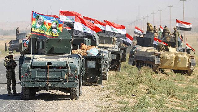 Иракские вонные продвигаться к городу Киркук в ходе операции против курдских боевиков. 16 октября 2017.