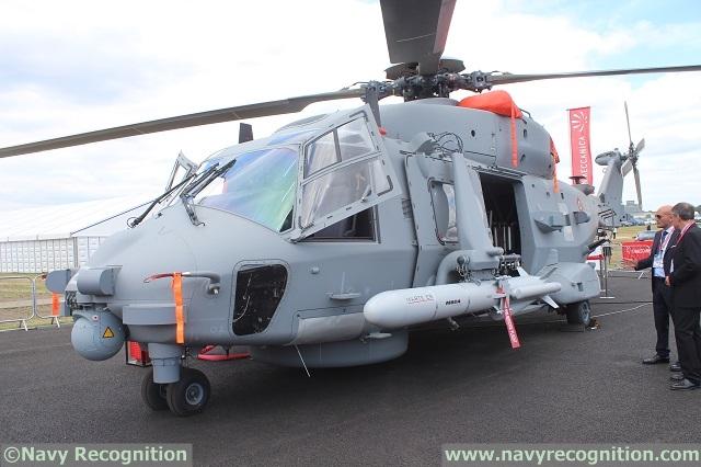 Вертолет NH90 NFH с  противокорабельными ракетами (ПКР) MARTE ER с увеличенной дальностью на Farnborough International Airshow 2014.