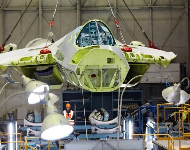Один из серийных образцов (второй?) истребителя Су-57 на сборке в цеху № 45 Комсомольского-на-Амуре авиационного завода имени Ю.А. Гагарина