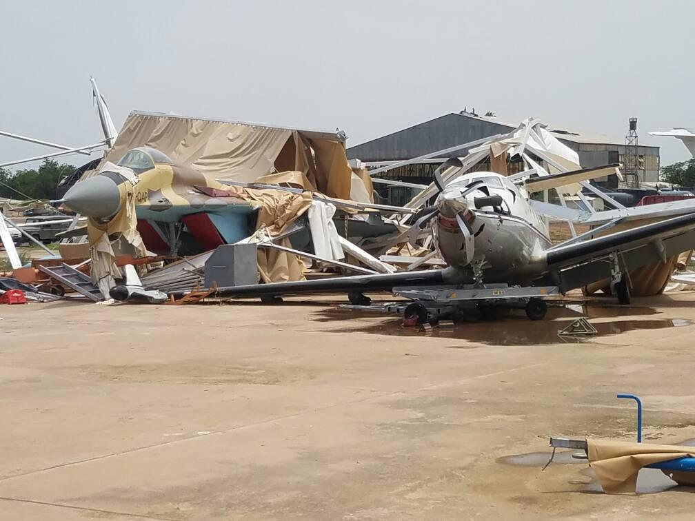 Поврежденный ураганом единственный истребитель МиГ-29 ВВС Чада - полученный в 2014 году с Украины самолет типа 9-13 (чадский регистрационный номер TT-OAP, заводской номер 2960710839). На втором и третьем снимках виден также поврежденный ураганом турбовинтовой самолет Pilatus PC-12 (регистрация ТТ-AAF) правительственного авиаотряда. Нджамена, 01.07.2017.