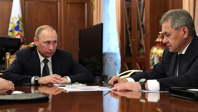 Президент РФ Владимир Путин и министр обороны РФ Сергей Шойгу. Архивное фото.