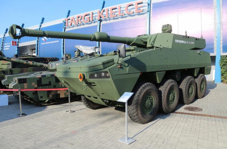 Демонстратор колесной ББМ на шасси БМП серии Rosomak и с башней Cockerill XC-8 со 120 мм гладкоствольной пушкой.