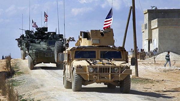 Силы США патрулируют окраину сирийского города Манбий в провинции Алеппо