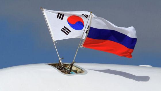 Флаги России и Южной Кореи
