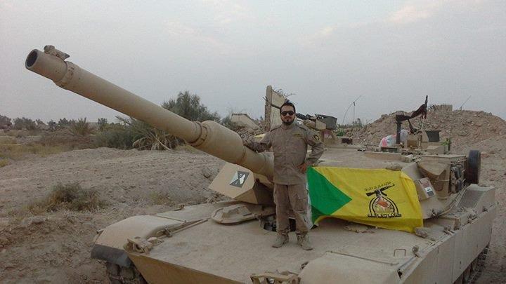 """Танк M1A1 Abrams иракской армии, использовавшийся иракской шиитской вооруженной группировкой """"Катаиб Хезболла"""", январь 2015 года."""