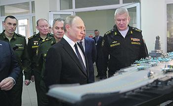 Верховному главнокомандующему представили макет нового авианосца. Фото с официального сайта президента РФ