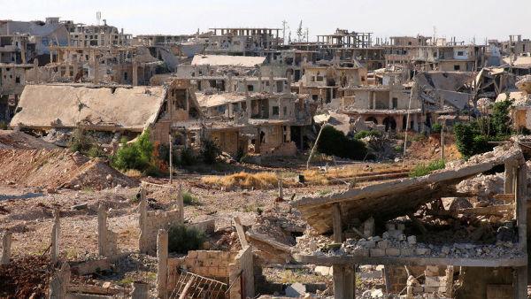 Вид на разрушенный город Даръа в Сирии, июнь 2017
