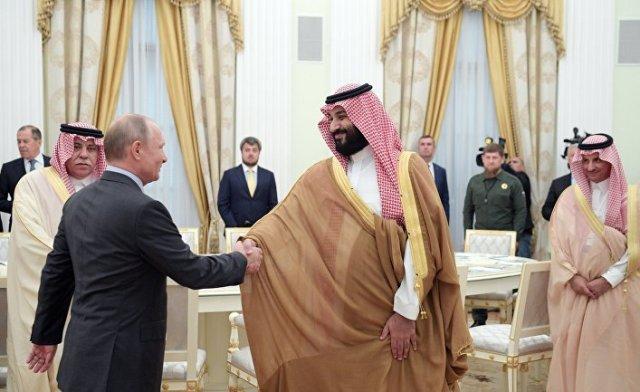 Владимир Путин и наследный принц Саудовской Аравии Мухаммед ибн Салман Аль Сауд во время встречи. 14 июня 2018